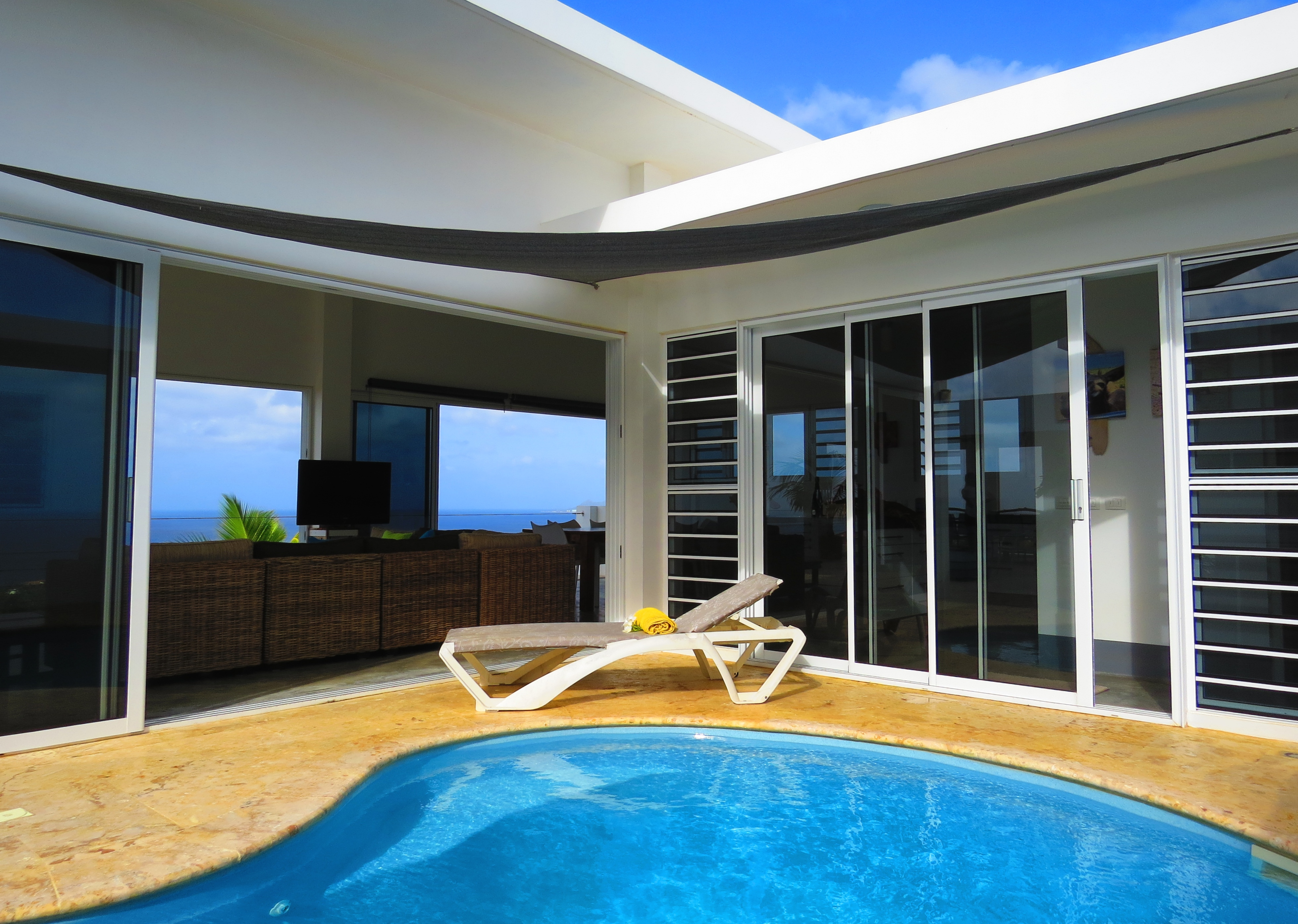 Enjoy sun or shade poolside