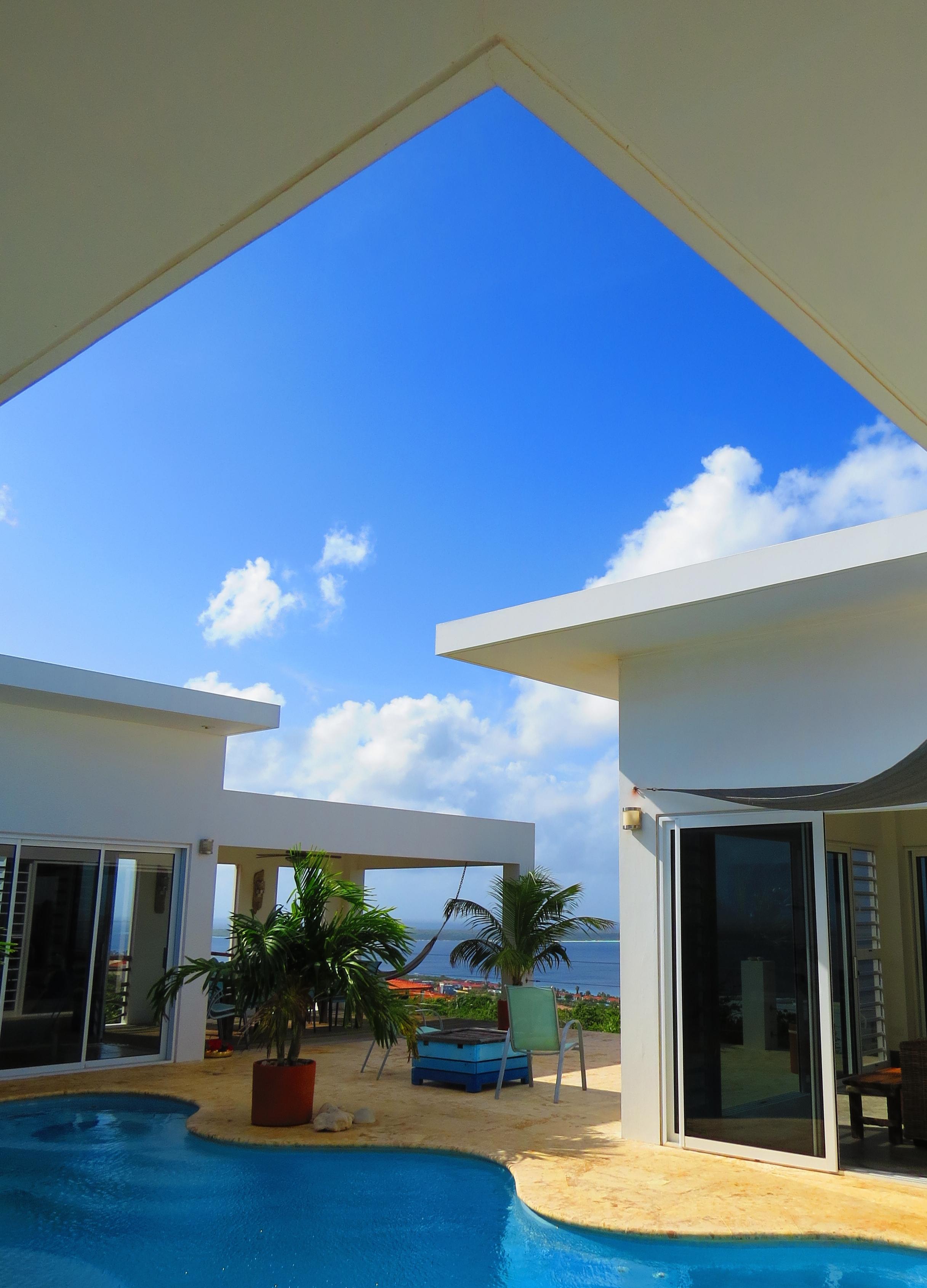 Blue pool, blue skies